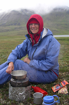 Cooking on a small stove on a cold July evening in the Brooks Range.