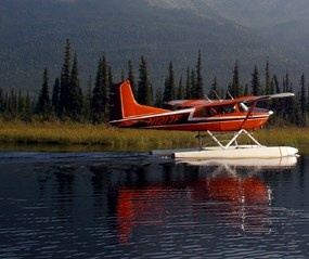 Float plane taking off of an arctic lake.