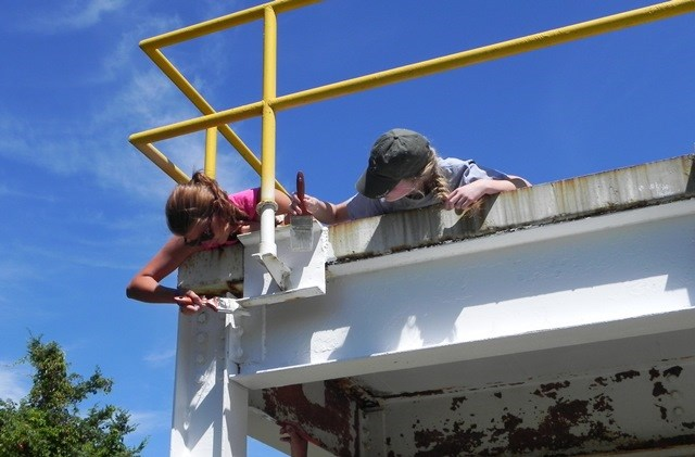 Youth from St. Charles Presbyterian Church in Missouri help repaint a radar platform in the summer of 2014.