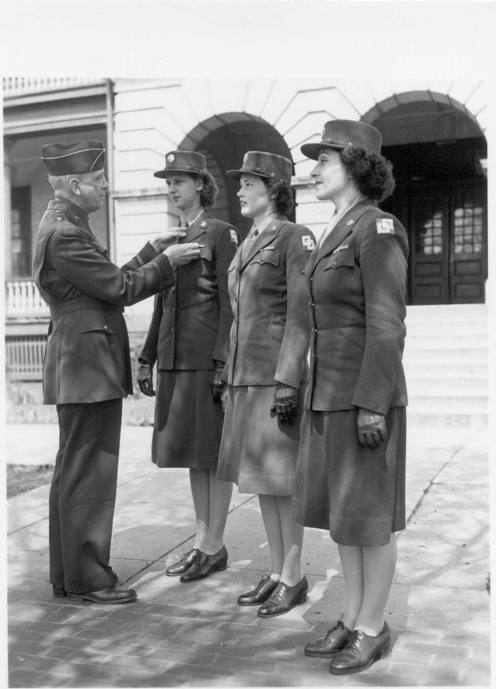 WACs receive good conduct medal.