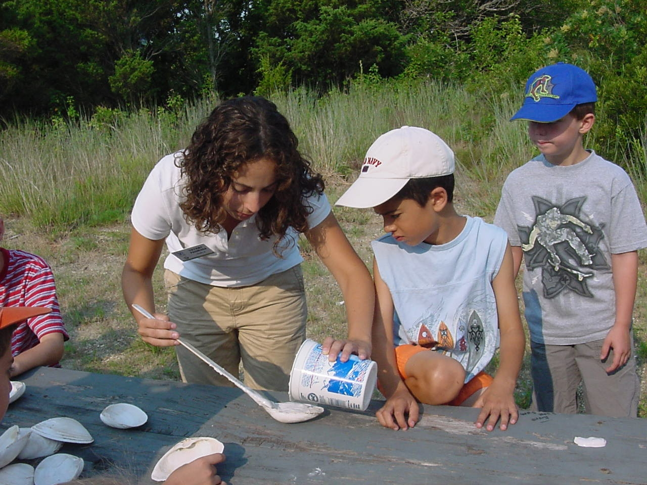Students at Sandy Hook working with a Student Conservation Association intern.
