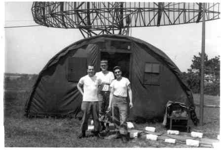 Soldiers outside a quanset hut with radar equipment, 1950s.