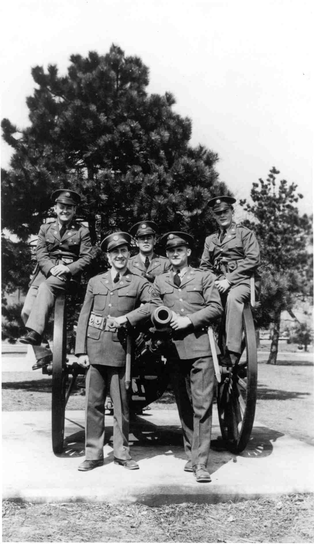 Soldiers pose on salute gun at flagpole on Fort Hancock Parade Ground, c. 1942.