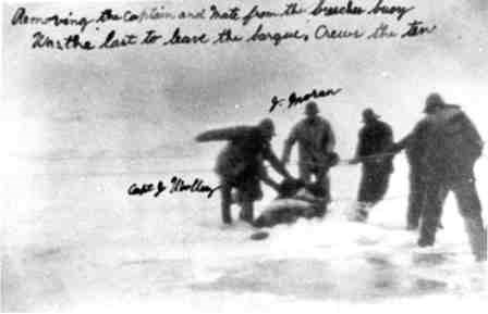 "Another photo of the rescue of the captain of the Edmund J. Phinney. Inscribed message says, ""Removing the Captain and Mate from the breeches buoy / Was the last to leave the barque [watercraft], Crews the ten [a crew of ten]"""