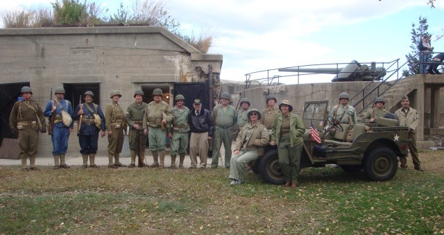 The Army Ground Forces Association poses at Battery John Gunnison. Who was John Gunnison? And why was his name removed from the battery (as seen in this photo)?