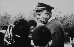Herbert Johnson leading a school group tour in 1958