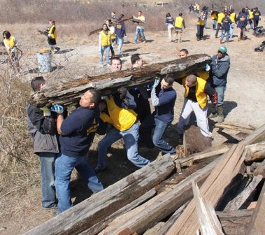 Volunteers from the Church of God clear debris from the last remaining salt marsh in the Rockaways.