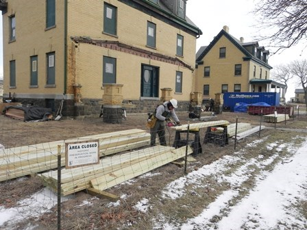 An NPS employee with the Historical Preservation Training Center in Frederick, Maryland, restores an historic porch at Fort Hancock's Officers Row, part of Gateway's Sandy Hook Unit.