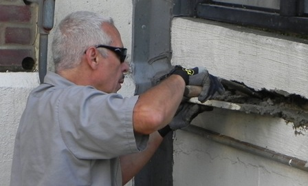 An employee in the maintenance division makes structural repairs.