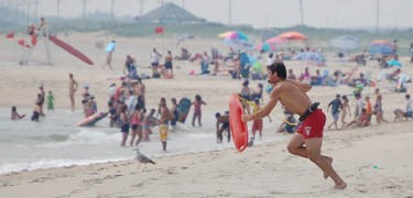 A surf-lifeguard at Sandy Hook Unit responds to a call for help.