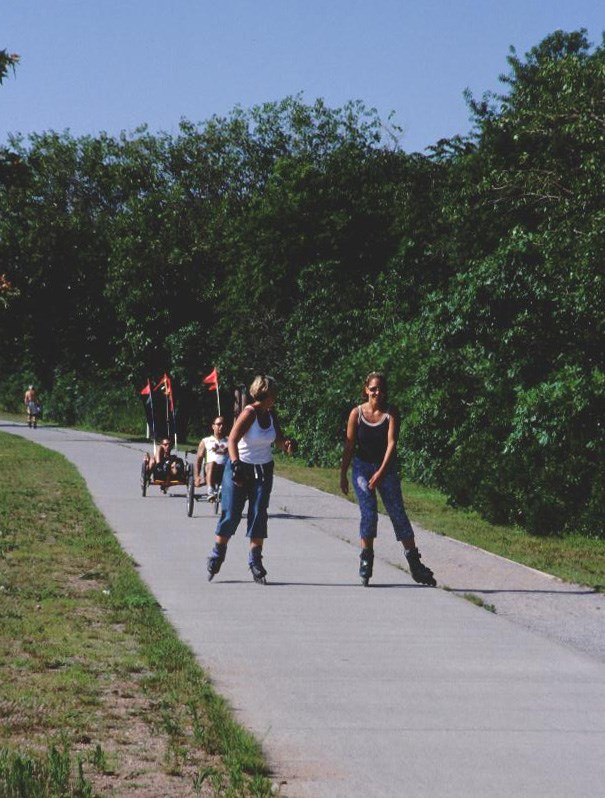 Roller blading and biking on the mutli use path at Great Kills Park