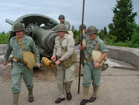 Living historians from the Army Ground Forces Association load the six-inch gun at Battery Gunnison. No, the ammo isn't live!
