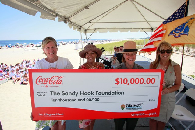 As part of Coca-Cola's America Is Your Park program, Linda Canzanelli, Superintendent of Gateway National Recreation Area, center right, and Betsy Barrett, President of the Sandy Hook Foundation, left, accept a$10,000 donation to Sandy Hook - Gateway National Recreation Area from Coca-Cola Refreshments' Dori Silverman, right, and New Jersey Division of Travel & Tourism's Phyllis Oppenheimer, center left,  on behalf of New Jersey Lt. Governor Kim Guadagno, at Sandy Hook, N.J., Wednesday, July 27, 2011.