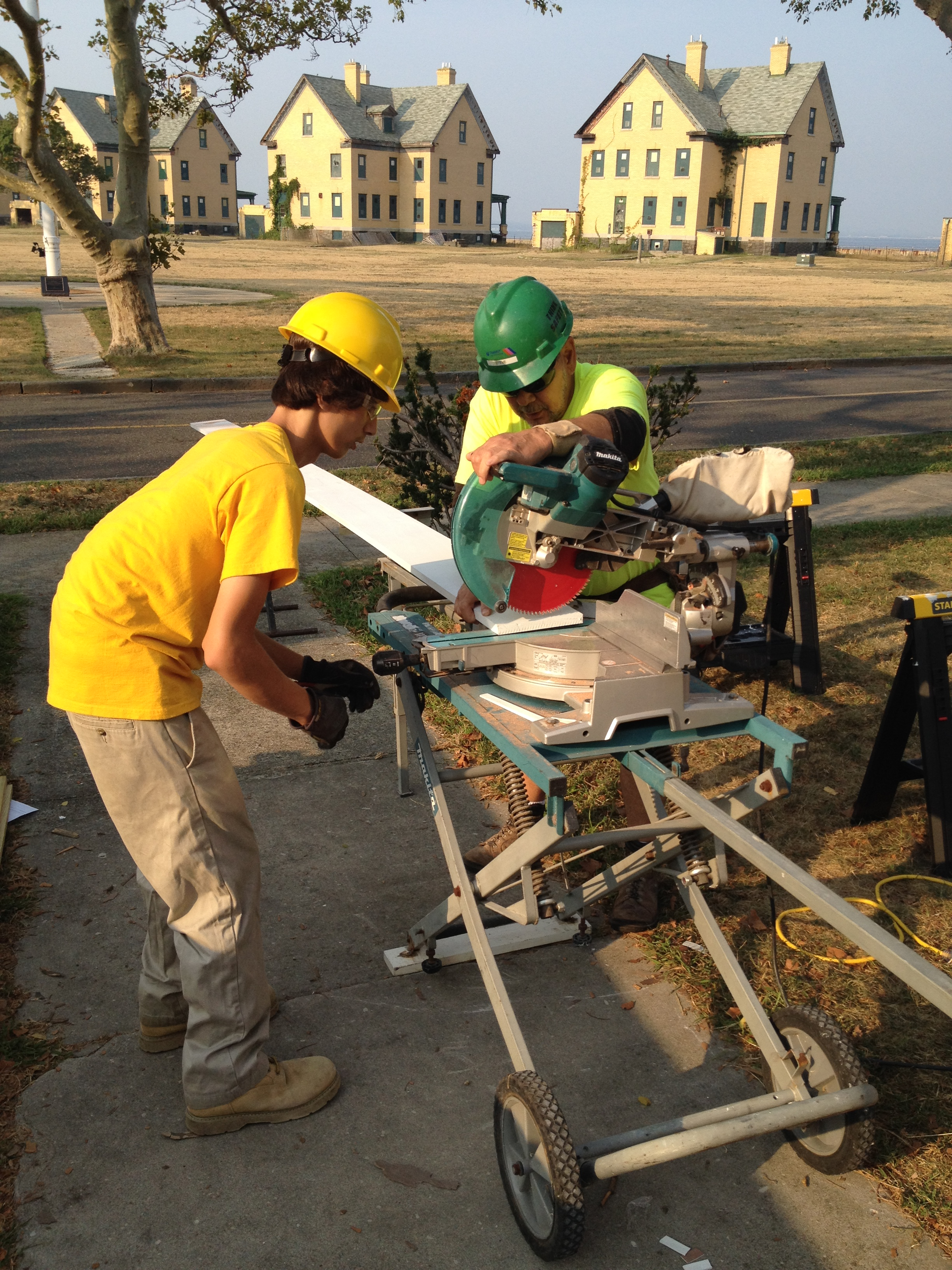 New Jersey Youth Corps Corpsmembers cut wood to rebuild an historic porch at Sandy Hook.