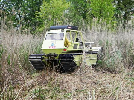 The MarshMaster cuts through phragmites near homes on Grayson Avenue, Staten Island.