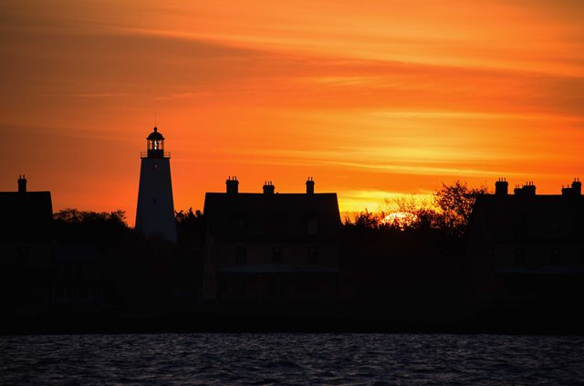 Officers Row and the Sandy Hook Lighthouse at sunset. Photo by Volunteer-in-Parks Stan Kosinski.