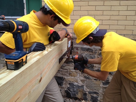 Phil Young and Louie Rodriguez work together to rebuild the historic porch on Fort Hancock's Building 26 as part of the crew from New Jersey Youth Corps of Phillipsburg.