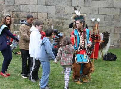 A member of the dance troupe Red Storm leads visitors in a Native American dance, including Miss Teen Staten Island.