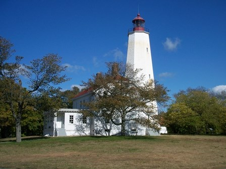 The 250-year-old Sandy Hook Lighthouse. The Lighthouse Keepers Quarters next door, built in 1883, is currently serving as the Sandy Hook Visitor Center.
