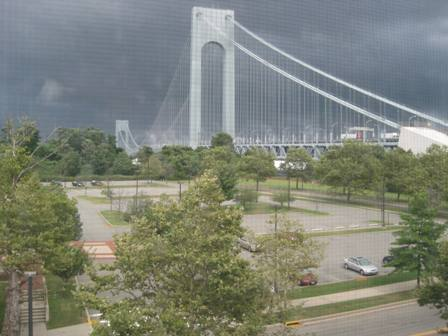 A storm approaches Fort Wadsworth and the Verrazano Bridge.
