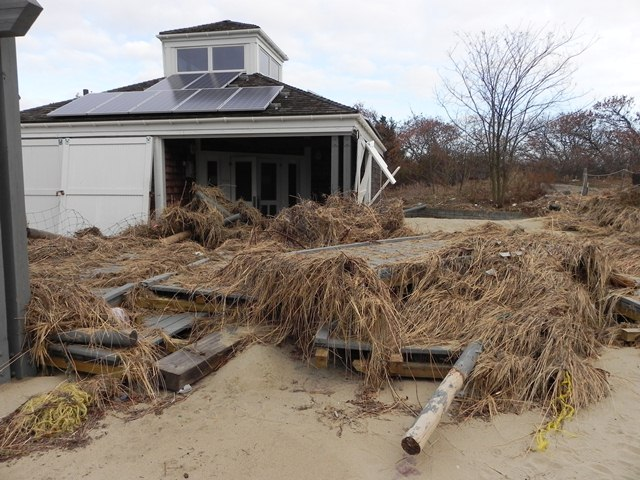 The beach center at Gunnison on Sandy Hook after Hurricane Sandy. Underneath the debris are pieces of the boardwalk which were displaced by the storm.