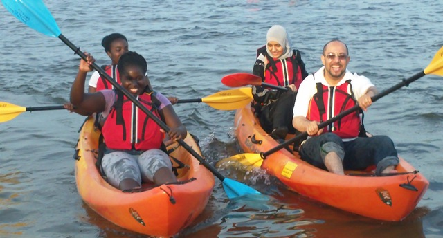 Kayakers in the waters of Jamaica Bay. Have fun... and wear a life jacket!