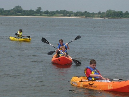 Children kayak in Jamaica Bay.
