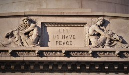 Let us Have Peace Epitaph carved on granite face of tomb