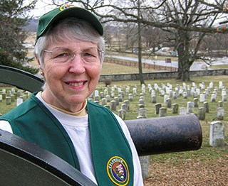 A park volunteer stands ready to help visitors in the Soldiers' National Cemetery.