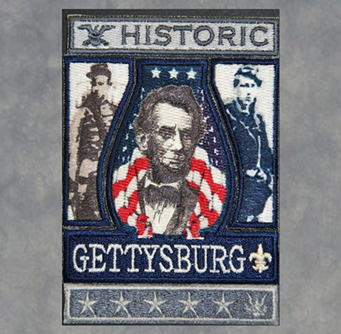 The Gettysburg scout badge has a picture of Abraham Lincoln and a Union and a Confederate soldier.