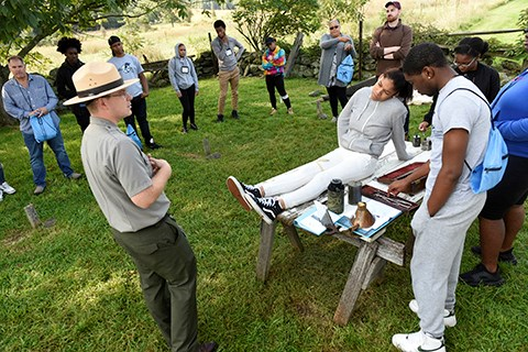 A park ranger presents an education program about Civil War medicine to a group of students.