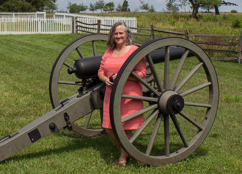 Winona Peterson standing next to a cannon.