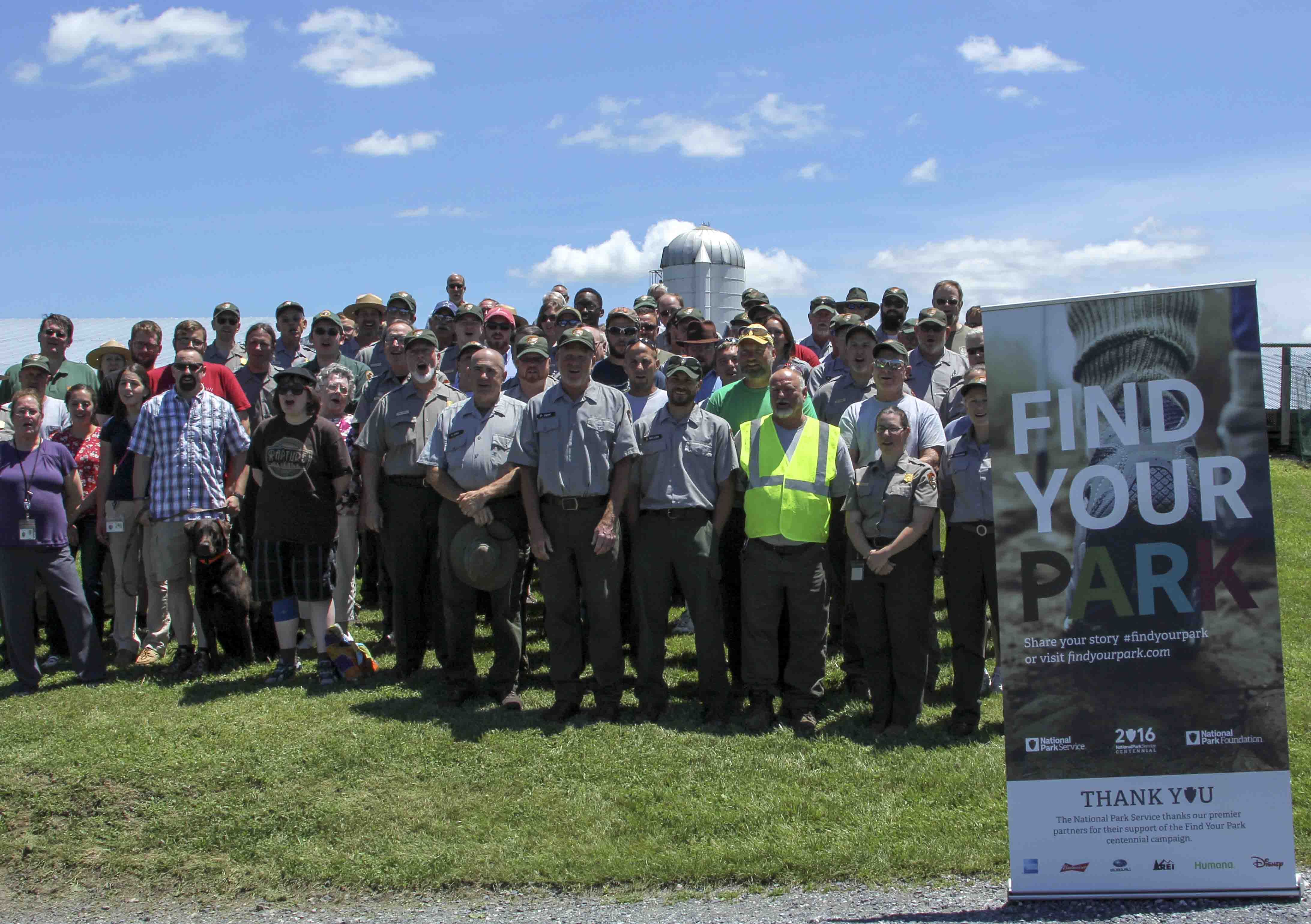 "Park staff at the Gettysburg and Eisenhower Parks with a ""Find Your Park"" banner in June 2016."
