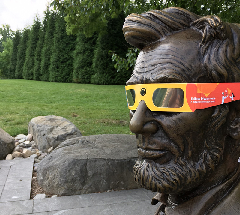 Abraham Lincoln statue wearing eclipse glasses