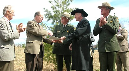 Officials at the Harman Farm transfer ceremony.