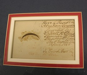 Framed lock of Lincoln's hair.