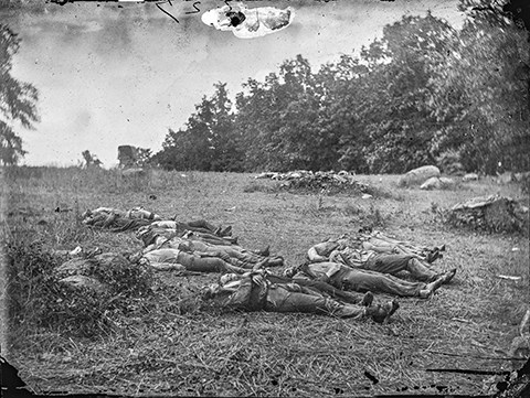 Dead soldiers litter the battlefield.