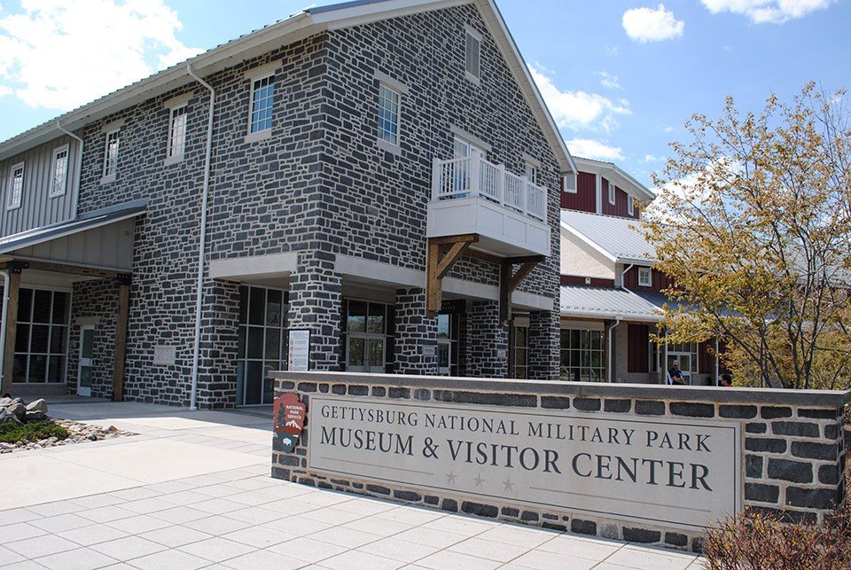 The front of the Museum and Visitor Center and the park sign.