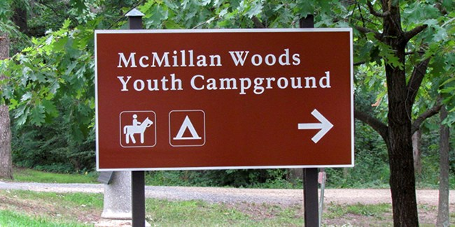 McMillan Woods Youth Campground sign