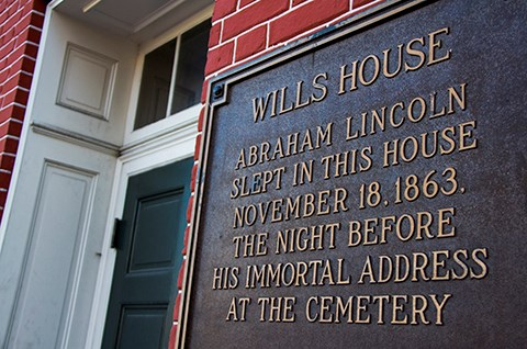 The sign at the front door of the David Wills house described how Abraham Lincoln stayed there on November 18, 1863.