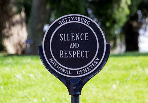 There are signs at the entrances to the cemetery that read Silence and Respect.