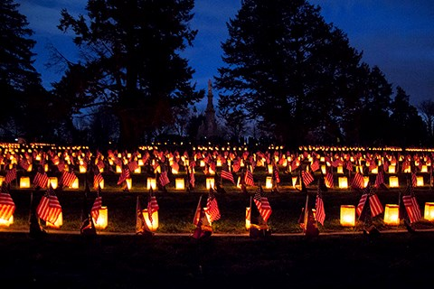 Luminaries and flags adorn the Civil War graves in the Soldiers' National Cemetery.