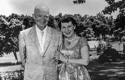 Dwight and Mamie Eisenhower stand arm in arm off the rear patio of their Gettysburg home.