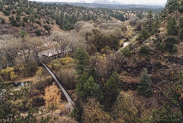 A photo looking down at the Contact Station from the Cliff Dwellings trail with fall foliage visable.