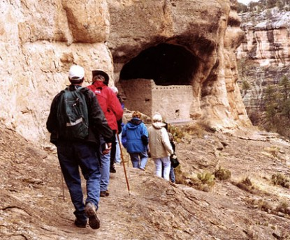 Visitors approaching the ruins on tour.