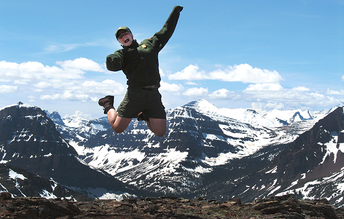 ranger leaps into air on mountain pass