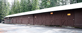 Long brown building with garage like doors
