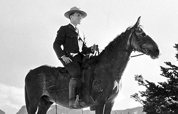 historic image of ranger astride horse