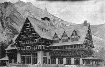 historic image of multistory hotel with many pitched gables and mountain in background