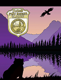 Cover of Jr Ranger book with bear on lake shore and eagle soaring over mountain background.